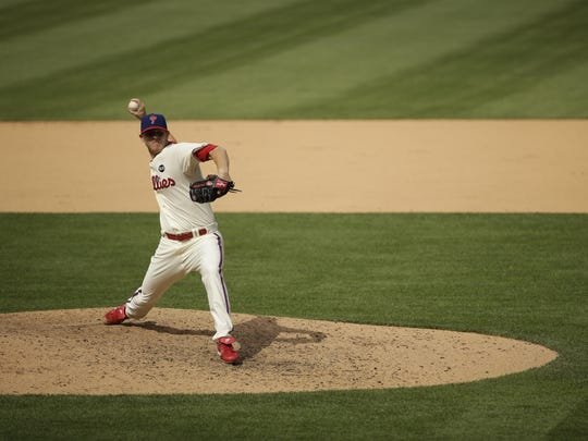 Philadelphia Phillies' Justin De Fratus, leader in inherited runners scored, threw a scoreless inning Sunday against the Colorado Rockies.