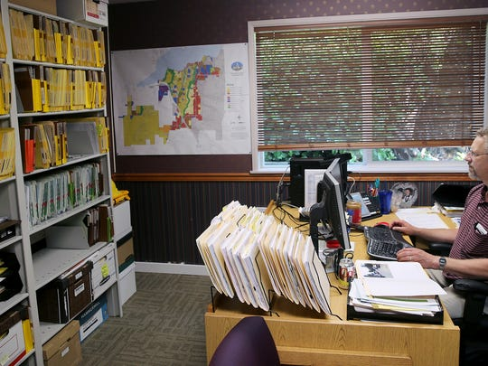Port Orchard code enforcement officer Doug Price in his office in the Prospect Street building.