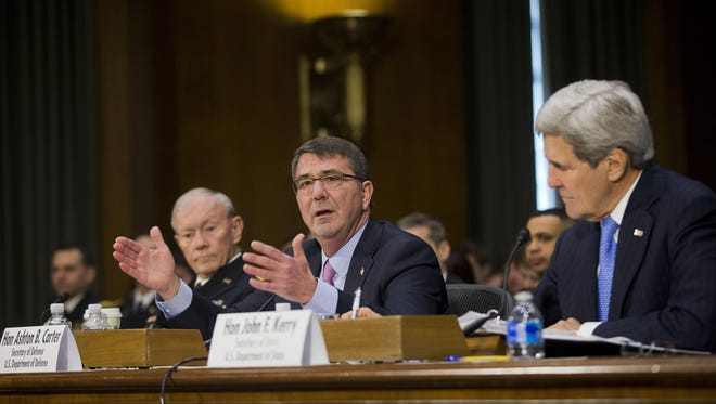 Defense Secretary Ash Carter, center, flanked by Secretary of State John Kerry, right, and Joint Chiefs Chairman Army Gen. Martin Dempsey, presents the White House case for new war powers to fight Islamic State group militants.