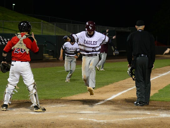 Snow Hill's Cole Gursky flys into home against Colonel