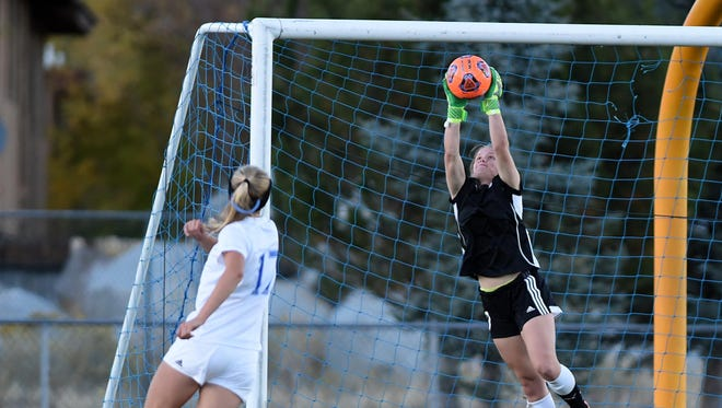 Action photos of the McQueen at Reno girls soccer match at Reno high on Tuesday Oct. 25, 2017.