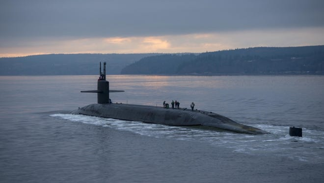 The Ohio-class ballistic missile submarine USS Pennsylvania (SSBN 735) transits the Hood Canal as the boat returns to its homeport at Naval Base Kitsap-Bangor, Wash., following a routine strategic deterrent patrol Dec. 27, 2017. Pennsylvania is one of eight ballistic-missile submarines stationed at the base, providing the most survivable leg of the strategic deterrence triad for the United States.