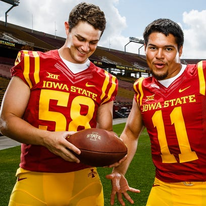 The Cyclones defensive ends Mitchell Meyers,left, and