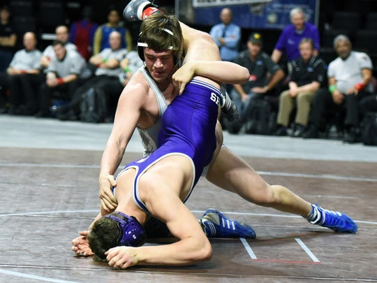 Joe Miller of McQueen scores a takedown of Colby Preston of Spanish Springs in the 195-pound gold medal match  at the 2018 NIAA State Wrestling Championship