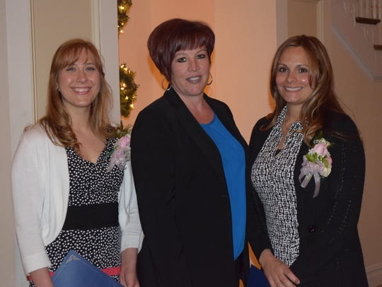 Superintendent Adrienne Shulby, center, is pictured