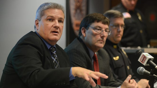 (L to R)  Buncombe County Sheriff, Van Duncan, District Attorney Ron Moore, and Wade Wood of the Asheville Police Department discuss the enforcement of video gaming laws during a press conference Monday last year.