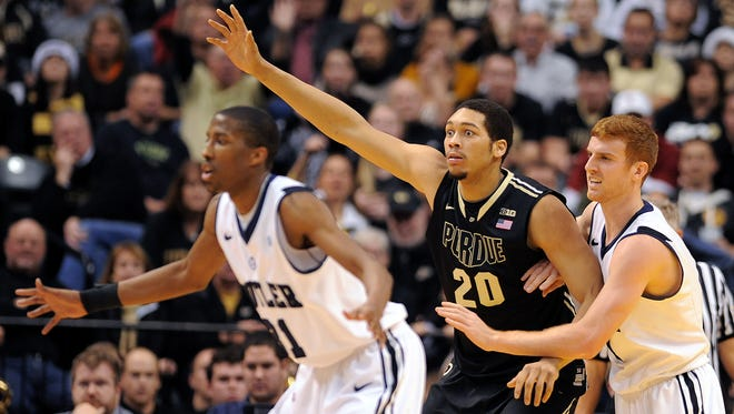 Purdue center A.J. Hammons calls for the ball in the low post against Butler during the second half, Saturday, December 14, 2013, at Bankers Life Fieldhouse.