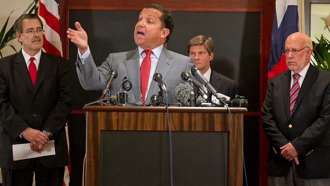 From left, David Botsford, Tony Buzbee, Bobby Birchfield and Ben Ginsberg address reporters during a media briefing held Monday, Aug. 18, 2014 at the Stephen F. Austin Intercontinental Hotel. Texas Gov. Rick Perry has assembled his legal defense team to fight charges levied against him by the special prosecution office.