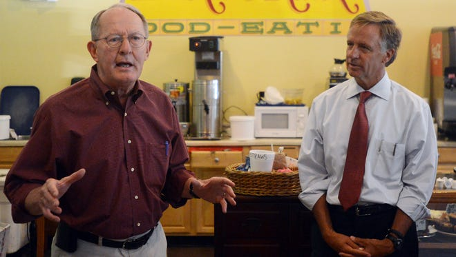 U.S. Sen. Lamar Alexander and Gov. Bill Haslam speak to supporters Monday at the Bakers Rack in downtown Jackson.