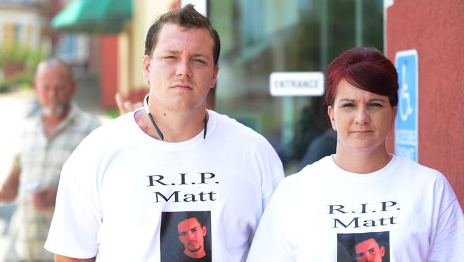 Jonathan Martin and Amy Vestal (from left to right) wear shirts to honor Robert Matthew Williams on Wednesday. A preliminary hearing for Jason Collins, accused of stabbing Williams in July, was held in Trenton.