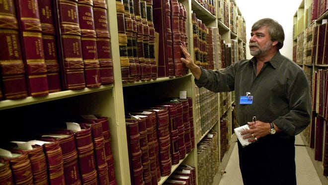 "State Archives Manager Jeff Kintop stands in the stacks at the Nevada State Library and Archives, in 2003, in Carson City, Nev. The room, known as ""the vault,"" includes original records and manuscripts of the territorial government in addition to other irreplaceable documents tracing Nevada's heritage."