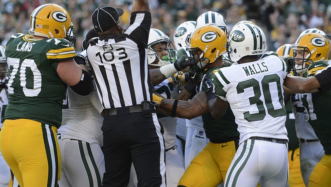 Green Bay Packers tight end Andrew Quarless (81) and New York Jets defensive lineman Sheldon Richardson (91) get into a scuffle at the end of a play in the third quarter during Sunday's game at Lambeau Field. Evan Siegle/Press-Gazette Media/@PGevansiegle