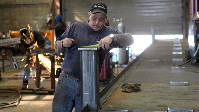 Larry Almeida lay out a part of a steel platform that will be used in the construction of the new Tappan Zee Bridge at Brakewell Steel Fabricators in Chester, March 11, 2014. The platform is about 90 feet long by 10 feet wide.