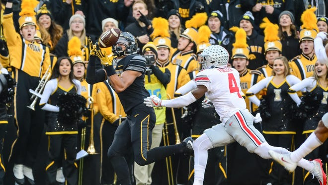 Iowa tight end Noah Fant beats safety Jordan for a touchdown. It was one of four TD catches by Iowa tight ends in the 55-24 win over the Buckeyes.