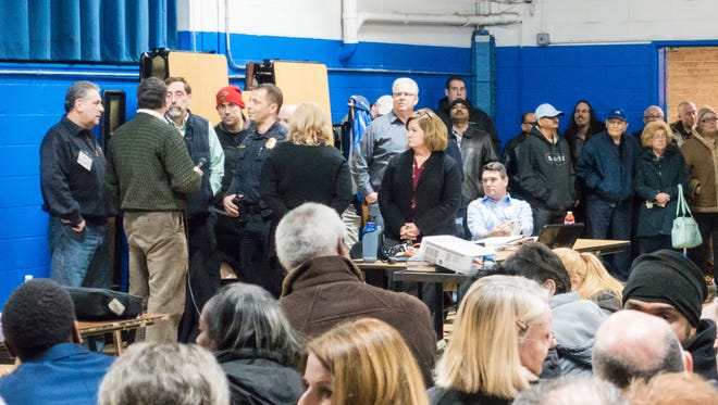 Lake Parsippany residents pack a meeting on Jan. 10 at Lake Parsippany School about a proposal to charges residents with an annual mandatory lake easement assessment. Police shut down the meeting when the crowd exceeded capacity at the school.