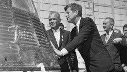 In this 1962 file photo, astronaut John Glenn and President John F. Kennedy inspect the Friendship 7, the Mercury capsule in which Glenn became the first American to orbit the Earth.