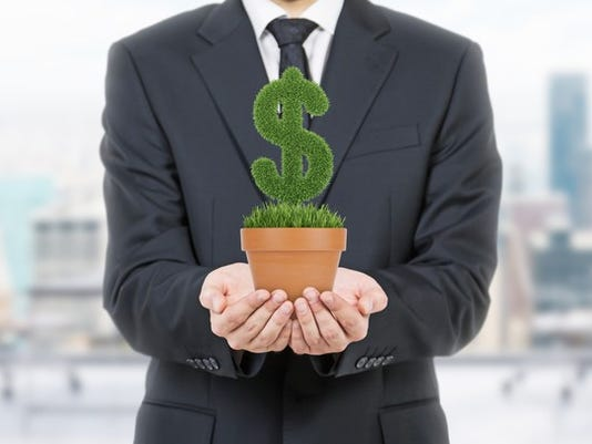 businessman-holds-dollar-sign-grass-pot-investing-getty_large.jpg