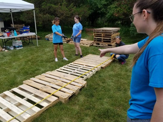 The Student Ambassadors build the furniture for the