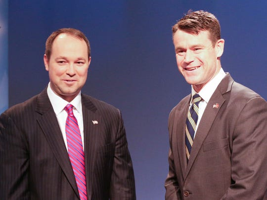 U.S. Reps. Marlin Stutzman (left) and Todd Young, Republican candidates for the U.S. Senate, greeted each other before their debate Monday, April 18, 2016, at the WFYI-20 studio in Indianapolis.