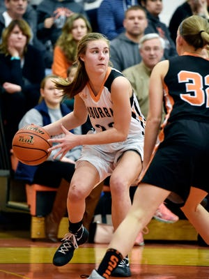 York Suburban's Ali Reinecker looks to pass the ball against Susquenita's Alyssa Spease in the second half of Wednesday's PIAA District 3 Class AAA girls' basketball game at York Suburban.