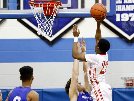 York Country Day School's DeAireus Brown puts up a