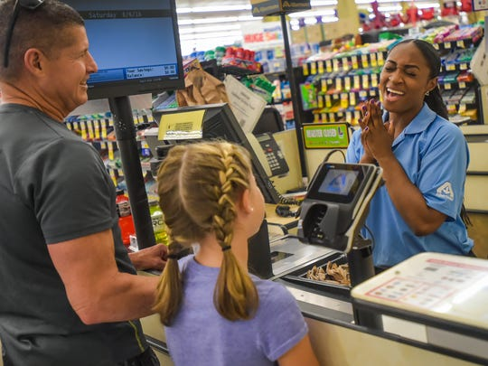 Domonique Williams, the Singing Cashier and customer