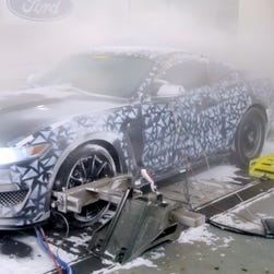 A Ford Mustang is subjected to blizzard conditions in Ford's test lab in Michigan