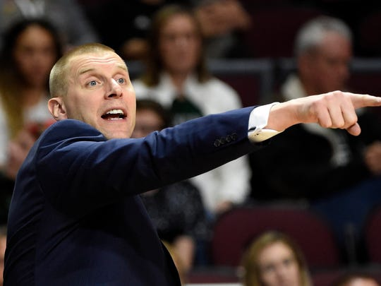 Utah Valley coach Mark Pope calls to his team during the second half of an NCAA college basketball game against Seattle in the first round of the Western Athletic Conference tournament Thursday, March 9, 2017, in Las Vegas. (AP Photo/David Becker)