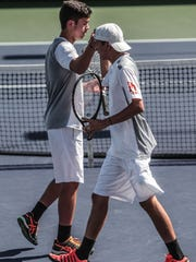 Christian Rozpedski, right, and Quinn Bush react to winning a point against Joshua Phillips and Emon Shaaf during an all Palm Desert DVL doubles final on Tuesday, April 24, 2018 in Indian Wells.