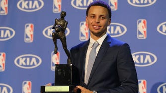 Warriors guard Stephen Curry with the NBA Most Valuable Player trophy at the Oakland Convention Center.
