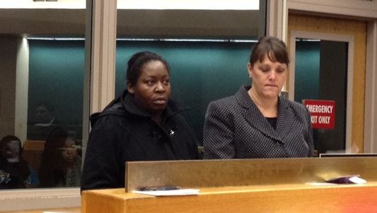Andriel Mathis, at left, in court in 2013.