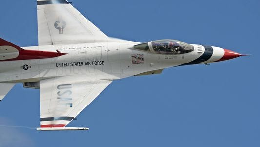 """A member of the Thunderbirds performs an aerial demonstration at the 2016 Shaw Air Expo and open house, nicknamed """"Thunder Over the Midlands,"""" at Shaw Air Force Base, S.C., May 21, 2016."""