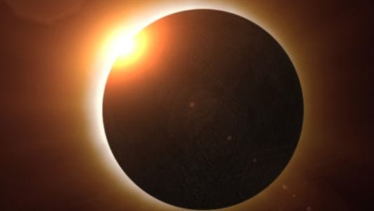 A total solar eclipse moments before totality.