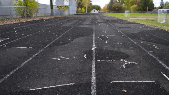 The Marshfield Middle School track, seen in 2013, has deteriorated to the point where the district no longer can host track meets.