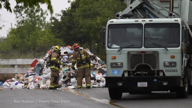 Visalia Fire Department investigates a  smoking garbage truck on Chinowth south of Caldwell.