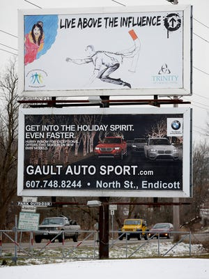 Spencer-Van Etten student E. Brian Martinez's winning design for Trinity of Chemung County's Art for Awareness poster contest has been turned into a billboard overlooking southbound Grand Central Avenue traffic in Elmira.