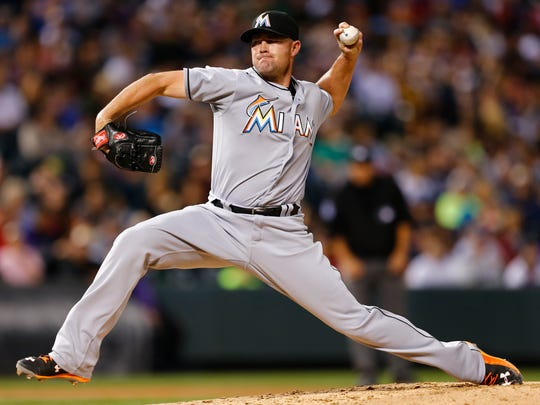 Miami Marlins relief pitcher Mike Dunn throws against