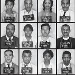 "Mug shots of John Lewis (bottom right corner) and other Freedom Riders arrested on May 24, 1961, after arriving from Montgomery, Alabama. Police arrested them after they entered a ""whites-only"" area in the Jackson bus station and refused to move on."