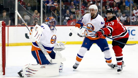 New York Islanders goalie Jaroslav Halak, left, of