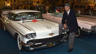 "Johnny ""Bootsy"" Morrow of Jackson leans on one of his many classic cars, this one a Cadillac, at his rental hall and private museum of Mississippi history."