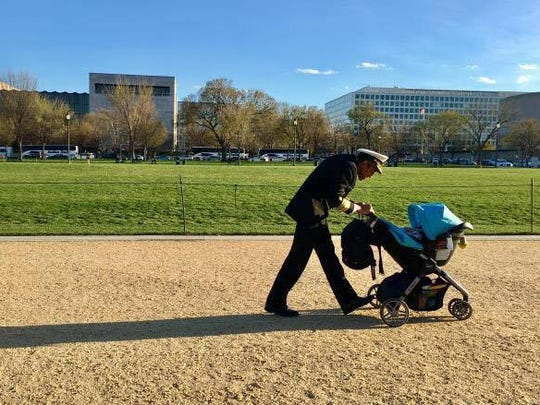 Former Surgeon General Vivek Murthy is shown walking his young son on the Washington, D.C. mall while he was in office.