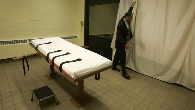 In this November 2005 file photo, public information director Larry Greene is shown in the death chamber at the Southern Ohio Correctional Facility in Lucasville, Ohio.