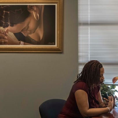 The painting hanging on Alishia Marshall's office wall