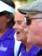 """Ninety-three-year-old Harald Casselman, right, sings with other members of the """"Vocal Point"""" quartet around Legislative Plaza on Saturday."""