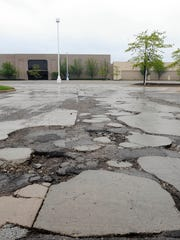 Plans to demolish the crumbling Summit Place Mall and build a 1 million-square-foot business park in its place got a boost from the Michigan Economic Development Corp. Tuesday, when its board approved a nearly $13 million tax abatement for the project.