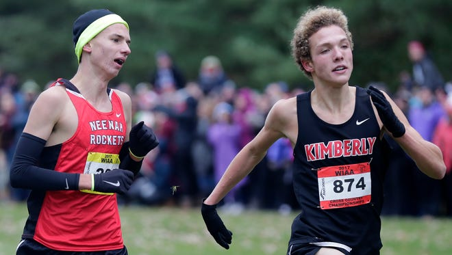 Kimberly's Rowen Ellenberg, right, and Neenah's Matt Meinke during the WIAA 2017 cross country state championship Boys division 1 race on Saturday, October 28, 2017, at Ridges Golf Course in Wisconsin Rapids, Wis.