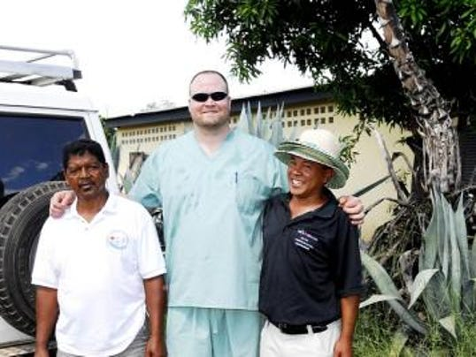 Former Penn State defensive end Justin Kurpeikis poses for a picture last year during a medical relief trip to Madagascar. Kurpeikis joined a non-profit organization called Operation Small Steps, which helps people in the island nation who suffer from orthopedic disabilities and other conditions. (Submitted)
