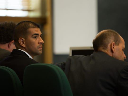 Former Las Cruces Police Officer Richard Garcia sits