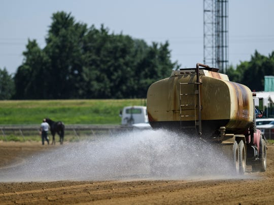 A large water wagon cools off the Ellis Park course between races, Friday afternoon, July 13, 2018. According to the National Weather Service the temperature hit 93 degrees on Friday afternoon.