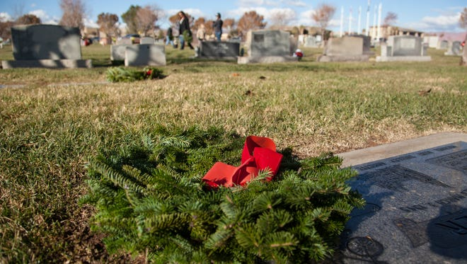 Veterans and members of the community gather at the Tonaquint Cemetery to honor veterans who have died Saturday, Dec. 12, 2015. Through the Wreaths Across America Organization, attendees laid wreaths on graves of friends and loved ones.